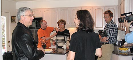 Director Julie Checkoway talks to Jim and Cookie Pappas in their kitchen as sound recordist Robin Hilton, cinematographer Richard Chisolm and assistant director Steve Lickteig make preparations to shoot.